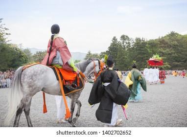 Aoi Matsuri Festival. Performers dressed in Heian-period costume parading through Kyoto Gyoen National Garden. - Shutterstock ID 1402702652