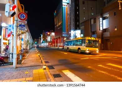 Aomori, Japan - April  23 2018: Night scene at Aomori mainstreet whith shopping malls market and Aomori train station at the the end of the street