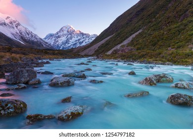 Aoraki Mount Cook behind the flowing Hooker river during the twilight of dawn in Hooker Valley Track, Aoraki Mount Cook Village, New Zealand