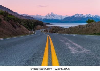 Aoraki Mount Cook in the dawn of pinky sky, New Zealand