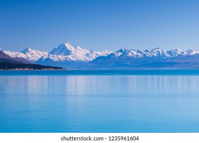 Aoraki Mount Cook and New Zealand Southern Alps along the turquoise Lake Pukaki in the clear blue sky day