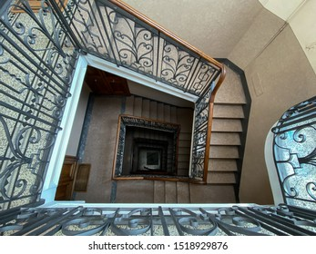 Aosta, Italy - 09 15 2019: Stairwell of an ancient renovated historic building photographed from above