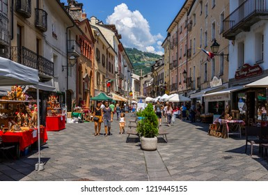 Aosta, Italy - August 4, 2018: People walking in the old town, in summer.