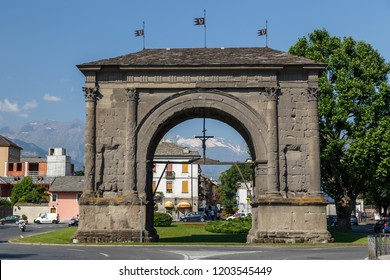 AOSTA / ITALY - JULY 2015: Ruins of Roman Triumphal arch in Aosta town, Italy