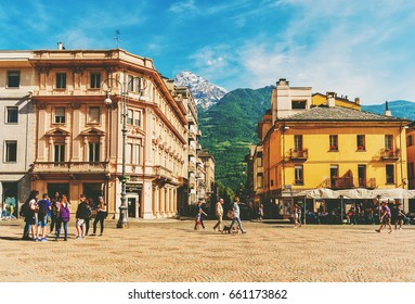 Aosta, Italy, May 25, 2017. Italy, Aosta, People walking on Central Plaza Emilio Chanoux near Municipality building