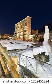 Aosta, Italy-12 December 2017 .The  Roman Amphitheatre covered in snow, in center of Aosta at night.