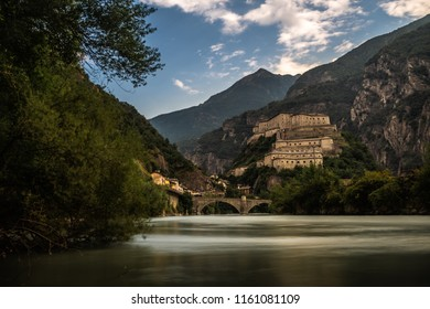 aosta old castle with river in north italy cloudy sky forte di bard