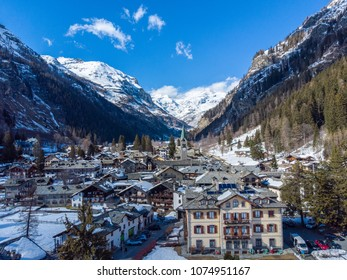 Aosta Valley, Italy. Chapel in Gressoney-Saint-Jean. View of alpine village Monte Rosa Gressoney, Aosta Valley Italy covered by snow in a cold winter season. Aerial view Alpine Village. Alps Landscape