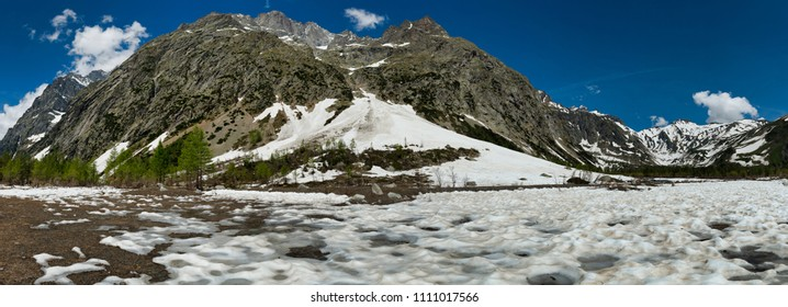 Aosta valley landscape in spring season during the melting snow in Val Ferret, beautiful day with blue sky