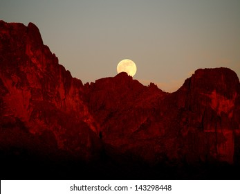 APACHE JUNCTION, AZ - JUNE 22: Full Strawberry Supermoon rising over the Superstition Mountains at sunset on June 22, 2013.