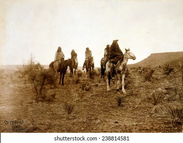 Apaches. Desert rovers- Five Apache on horseback in desert. photo by Edward S. Curtis, 1903