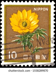 APAN - CIRCA 1980: a stamp printed in the Japan shows White Trumpet Lily, Lilium Longiflorum, Adonis amurensis, Flower, circa 1980