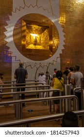 Aparecida / SP / Brazil - September 12 2020 - People praying in front of the Image of Our Lady Aparecida, patroness of Brazil, in the niche built in her sanctuary in Aparecida