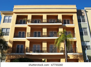 Apartment balconies with iron railings in bright winter sunlight in Florida.
