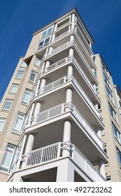 An apartment block against a blue sky