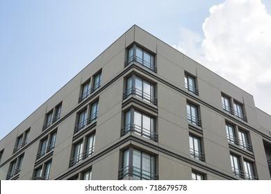 Apartment block flat blocks building blue sky background