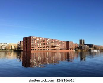 apartment blocks on Java island, Amsterdam, the netherlands - 4 December 2018: apartment buildings on water edge of Java Kade, Java Island Amsterdam