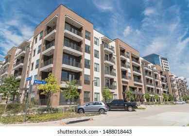 Apartment building with cars on outdoor parking garage in suburbs area of Dallas, Texas, USA. New development multi-Storey flat unit, group housing complex condos for modern living style