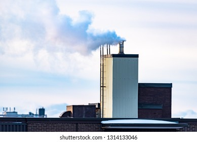 Apartment building chimney releasing vapor in Winter time. The 2018/2019 Winter season has seen some of the coldest temperatures on record