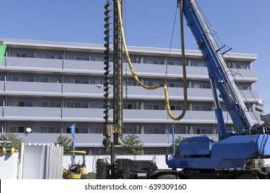 Apartment building construction pile driver