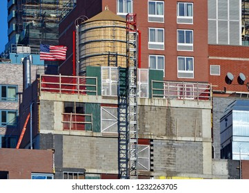 Apartment Building Exteriors in New York City with water tower and American Flag