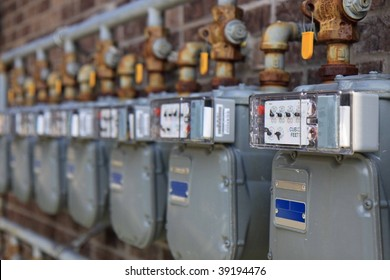Apartment building gas meters close up with shallow depth of field