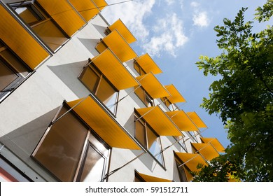 apartment building with happy windows and yellow sun filters