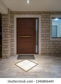 apartment building main entrance wooden door and window, night view
