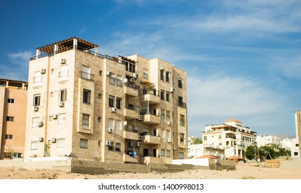 apartment building object for living on the edge of Eastern city in dry sand desert outdoor environment