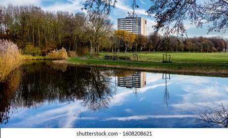 Apartment building reflections in the Madestein park in November in The Hague