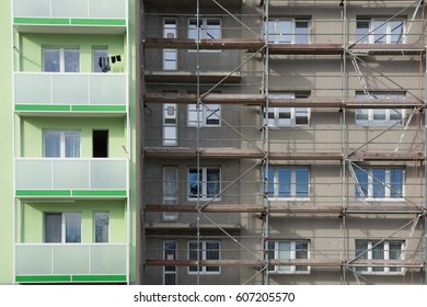 Apartment building with scaffolding. Apartment building thermal insulation mineral wool slabs. Insulated apartment building
