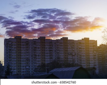 Apartment building at sunset block of