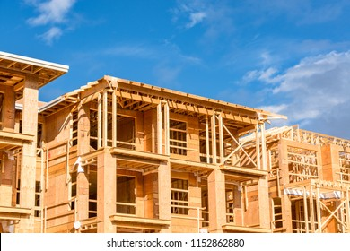 Apartment building under construction on sunny day on blue sky background