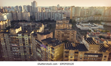 apartment buildings are gray and white. a view of the roof from the high buildings of the city of Kiev. residential areas of the city