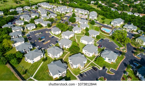Apartment buildings and multistory townhomes a new development urban housing and Austin living - Aerial drone view - modern curved roads and large townhomes