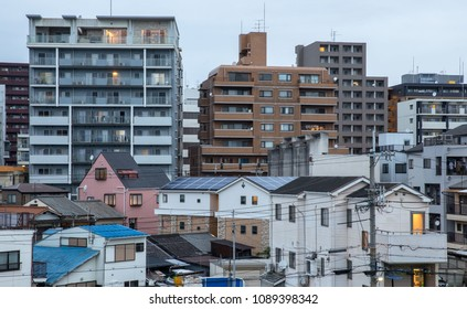 Apartment buildings and small houses in urban area of Japan