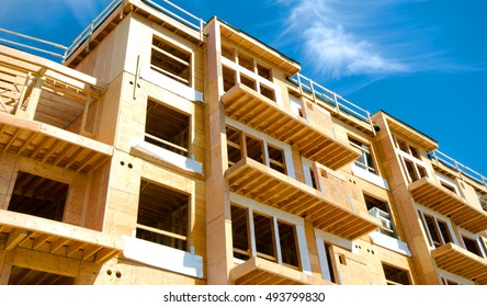 Apartment Condominium Complex, Wood Frame Construction, Victoria, Canada.  Blue Sky background