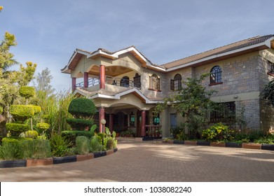 Apartment house with a beautiful entrance porch and a flower bed in the city of Nairobi in Kenya