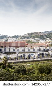 apartment and houses build on the side of a mountain in spain