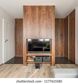 Apartment interior with trendy wooden wall and white doors