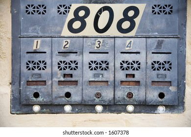 Apartment mailboxes with numbers in a big city
