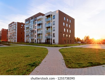 Apartment modern house and home residential buildings complex real estate concept. Street and outdoor. At sunset
