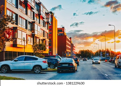 Apartment modern house and home residential building complex real estate concept. And street car parking. At sunset