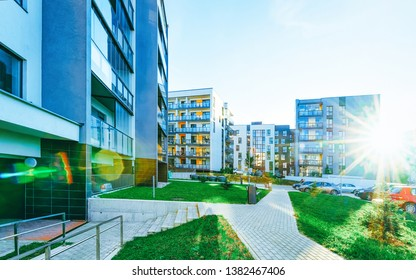 Apartment modern houses and homes residential buildings complex real estate concept. Street and outdoor. At sunset