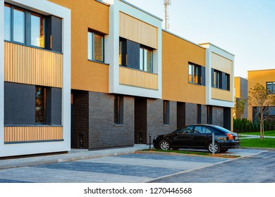 Apartment modern townhouse residential building and car parked in the street.