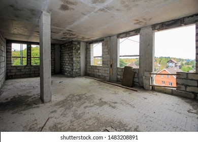 apartment in new building with free layout, repair, decoration with bare walls. large panoramic French window on wall. Concept: housewarming, building. Large lobby lounge. Premises under construction