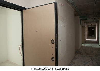 Apartment renovation. Plastered walls, wallpapering, painted ceiling, leveled floor. Electrical wiring installation. Empty light interior. Modern design