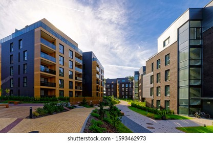 Apartment in residential building exterior. Housing structure at blue modern house of Europe. Rental home in city district on summer. Wall and glass high architecture for business property investment.