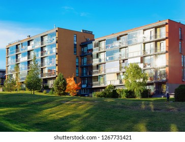 Apartment residential house and home facade architecture and outdoor facilities. Blue sky on the background. Sunlight