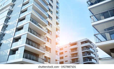 Apartment residential house and home facade architecture and outdoor facilities. Blue sky on the background. Sunlight in sunrise.